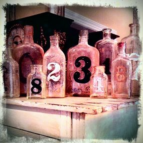 My old number bottles, cheapest creation ever. A must for me is that the bottles be old and dirty full of character!~