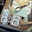 Antique letters and a babies tarnished spoon bring back memories of years gone by.