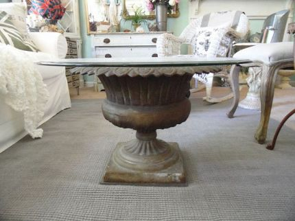 I took an antique cast iron garden urn and turned it into a beautiful coffee table.