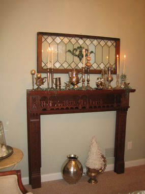 This is a cherry fireplace mantel I purchased several years ago at a local antique store.  I love all the details it has.  As Gretchen mentioned in the previous post, it can really make a piece.