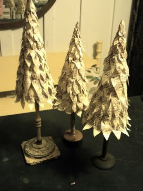 I made three Christmas trees and added old chair spindles and a variety of bases to add height and interest.