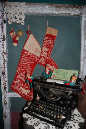 I found this old screen on the curb in my neighbrohood on trash day.  I added the old stockings I found at an estate sale.  I put my letter from Santa... 1960:s.. in the typewriter.
