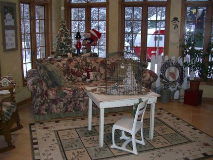 It is hard to see in the picture, but on the table is a large birdcage that was a recent purchase at a local barn sale. I cant wait to decorate it for all the seasons. My grandsons love the little table and chair, it is a favorite place to play.