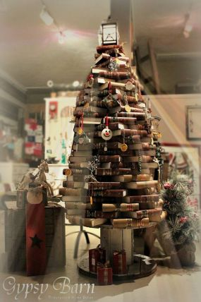 How fun is this? Oh we had some good laughs making this. What on earth would YOU do with this many books. Oh, this is just 1/3 of them. But hey! It works! The store is looking pretty junkalicious for Christmas now!