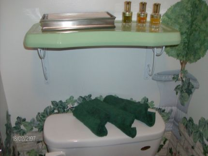 I am renovating a 1928 American Foursquare and turning it into Americas First Nostalgic Guest House.  Well I had an old toilet in the basement that just had to go down the crapper --- but I kept the vintage green tank lid -- and used it in a new powder room as a Porcelain Shelf!  Just add a set of brackets from your local Home Depot or Lowes and for less than $10 -- youve got an awesome Porcelain shelf for the bathroom.  Even better yet -- if you have an old radiator in your bathroom -- set the tank lid on top -- and youve created the most inexpensive towel warmer on the planet!!