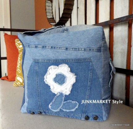 Thrift store jackets and jeans were used to ake this pretty and practical pouf. Use to sit on, as a foot rest and to store stuff you want on hand!