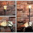 Vintage wooden shoemakers last & vintage metal roller skate, topped off with a black metal cage lamp shade.