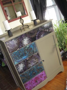 i painted an old brown dresser then added funky fabric and new hardware to give this piece a lift.