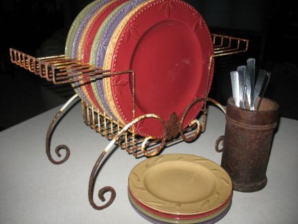 Here, sitting on the kitchen island, it holds the plates guests can grab while going through the buffet line.  (FYI: the rusty deal holding the silverware is piece of farm machinery - a disc spool).