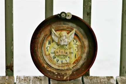 now is the only time we have...   The past, the present and the future are really one: they are today. Harriet Beecher Stowe   Made with an old pie plate, two old clock faces, clock gears, a cherub, scrabble tiles, and beeswax