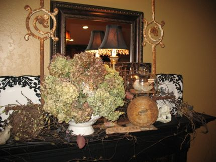 Last years summertime mantel.  Theres a lot of old stuff going on...maybe too much?  Not!